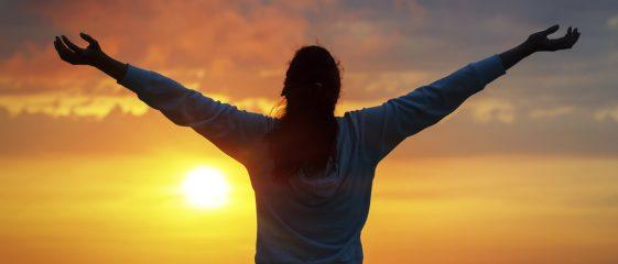 Freedom woman on sunset sky